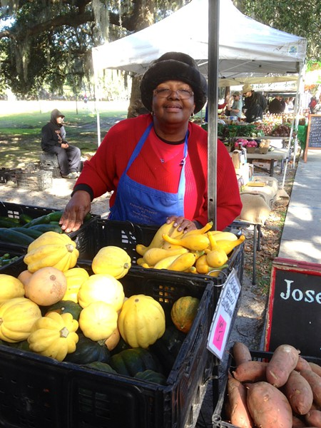 Helen Fields of Joseph Fields Farm has a welcome smile for everyone who visits her display of organic produce at Forsyth Farmers' Market.      Helen Fields of Joseph Fields Farm has a welcome smile for everyone who visits her display of organic produce at Forsyth Farmers' Market.