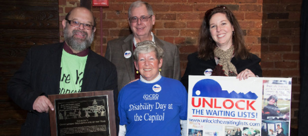 Eric Jacobson with the Tumlin family at the 2013 Disability Day Awards presentation