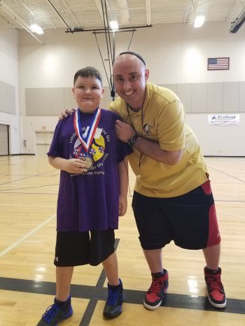 """Mighty Mike"" Simmel with camper Noah Mote"