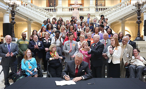 Governor Deals signs the Family Care Act