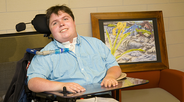 Person with disabilities in a wheelchair with assistive technology.